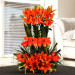 Two step arrangement of Asiatic Lilies and Roses